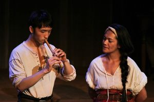 Yosan An as Yee plays flute for Elsie (Awhina-Rose Henare Ashby)