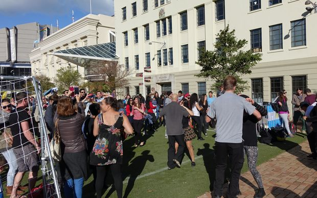 "Fans dancing to 'Cumbia Bros' at the ""Fever Pitch Fan Hub"" in Civic Square"
