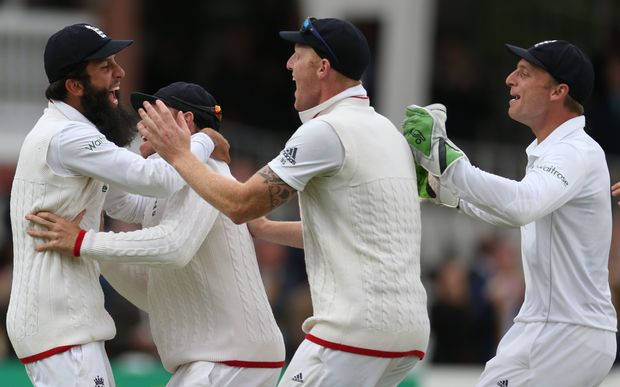 England's Moeen Ali (left) celebrates catching New Zealand's Trent Boult to win the first Test at Lord's Cricket Ground.