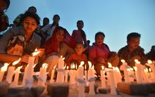 A candle lit vigil in Kathmandu on 25 May, a month after the deadly earthquake struck the Himalayan nation.