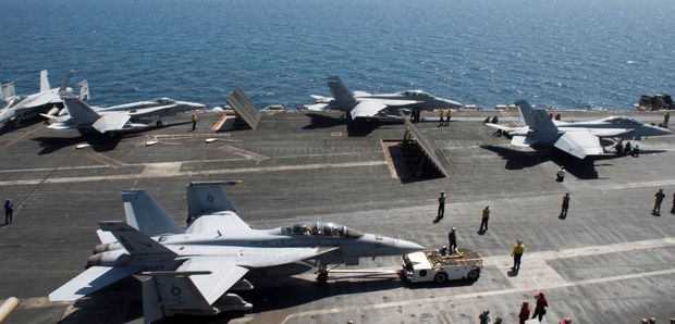 US Aircraft prepare for flight operations on the USS Theodore Roosevelt