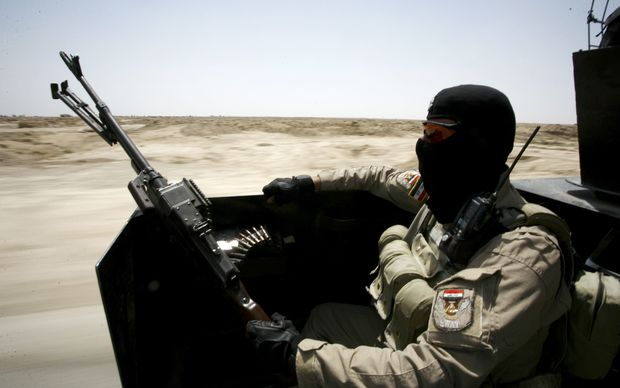 An Iraqi government soldier patrolling in the Jurf al-Sakher area, some 50km south of Baghdad.