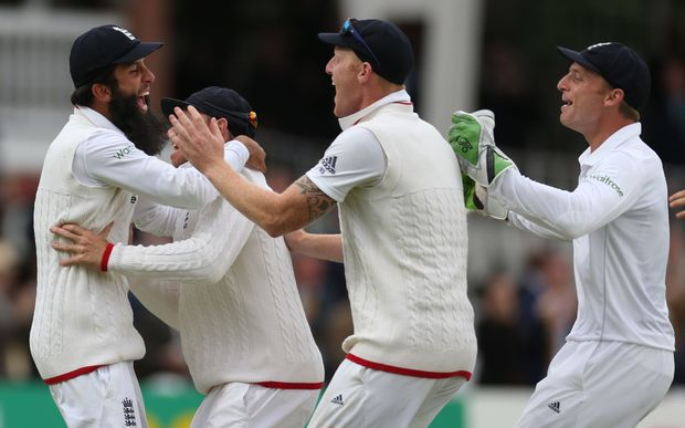 Moeen Ali (left) celebrates catching Trent Boult to win the first test at Lord's.