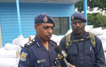 Papua New Guinea Police National Capital District (NCD) Metropolitan Commander Andy Bawa (left).