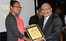 PNG Prime Minister Peter O'Neill presents an award at the PNG Human Resource Institute National Congress.