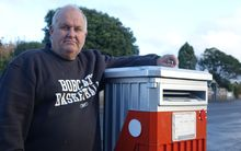 Stephen Parkes is surprised the mail box outside his auction business has been earmarked for removal.