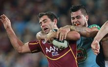 Queensland skipper Cameron Smith (left).