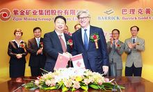 Zijin Mining Group Chairman Chen Jinghe (left) and Barrick Gold Corporation Chairman John L. Thornton (right) signed a strategic cooperation agreement at a ceremony at Zijin's offices in Xiamen, China on May 26, 2015.