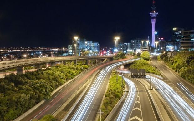 Auckland streets at night with long exposure turning  car headlights to light  ribbons