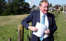 Housing and Building Minister Nick Smith at the Massey East parcel of Crown land identified for housing in Auckland.