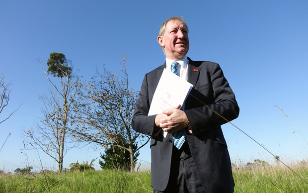Housing and Building Minister Nick Smith at Crown land at Manukau in Auckland that has been identified for housing.