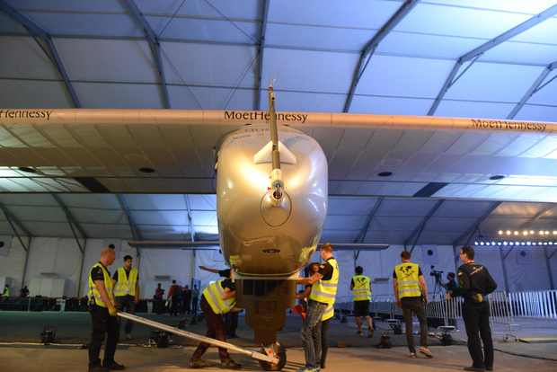 Ground crew members inspect Solar Impulse 2 at Sardar Vallabhbhai Patel International Airport.