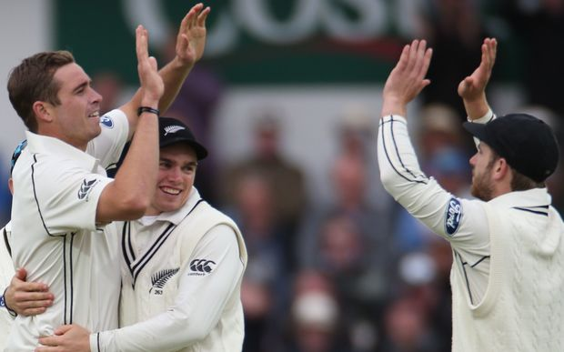 The New Zealand bowler Tim Southee (left) celebrates taking wicket.