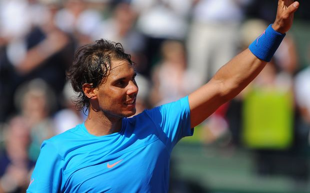 The nine times French Open champion Rafael Nadal celebrates after winning his match at Roland Garros.