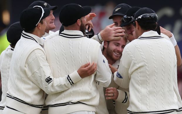 England's Ben Stokes is caught by New Zealand wicket keeper Luke Ronchi off the bowling of Kane Williamson (centre, facing) during the second Test New Zealand at Headingley, Leeds.