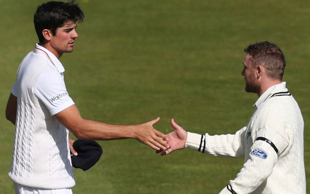 The England captain Alastair Cook (left) shakes hands with his opposite Brendon McCullum, after New Zealand win the second Test by 199 runs.