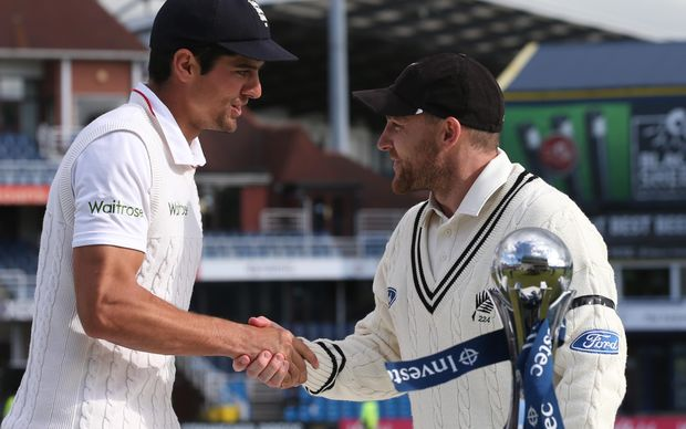 New Zealand cricket captain Brendon McCullum (right) and his England counterpart Alastair Cook share the spoils.
