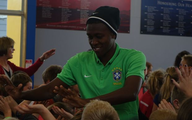 Brazilian player Jaja of the Flamengo club high fives children from Oakura Primary School.