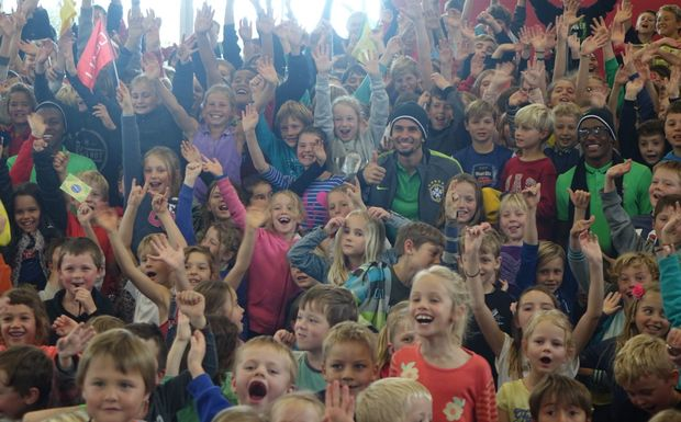 Brazilian players Jaja, Caju and Marcos are mobbed at Oakura Primary School southwest of New Plymouth.
