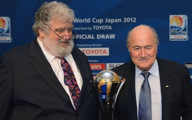 Ex-Fifa-Member Chuck BLAZER (USA, FIFA Executive Committee) and outgoing FIFA President Sepp Blatter posing with the Club World Cup in 2012.