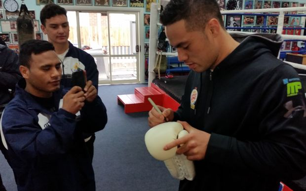 Joseph Parker signs autographs for fans at the Naenae Boxing Academy in Lower Hutt.