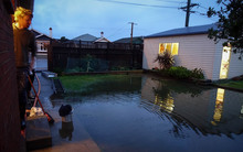 South Dunedin resident Nick Bakehouse shows the water in his backyard.