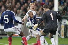 The French footballer Thierry Henry controls the ball with his hand against Ireland.