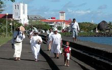 Samoans walking on the waterfront in Apia