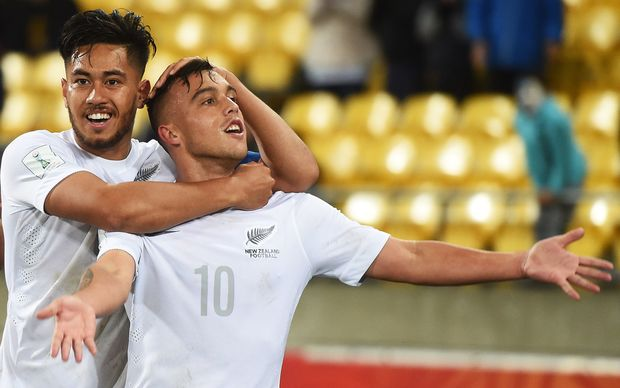 Captain Bill Tuiloma and Clayton Lewis celebrate a goal against Myanmar