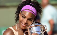 The world number one American Serena Williams clutches the 2015 French Open trophy.