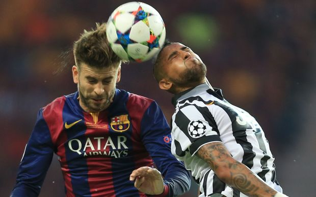 UEFA Champions League Final 2015. Barcelona's Gerard Pique fights for the ball with Arturo Vidal of Juventus.