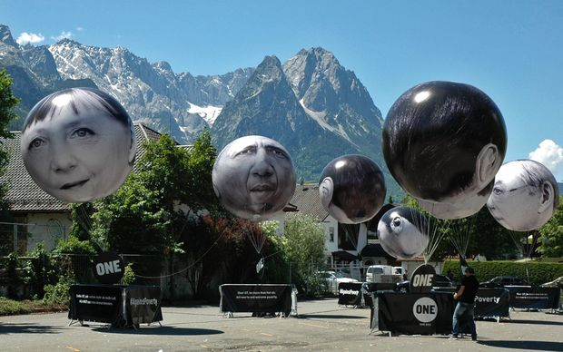 Balloons with faces of leaders at the G7 summit.