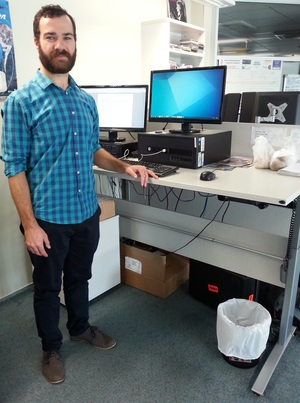 A photo of Dan Archer at a standing desk