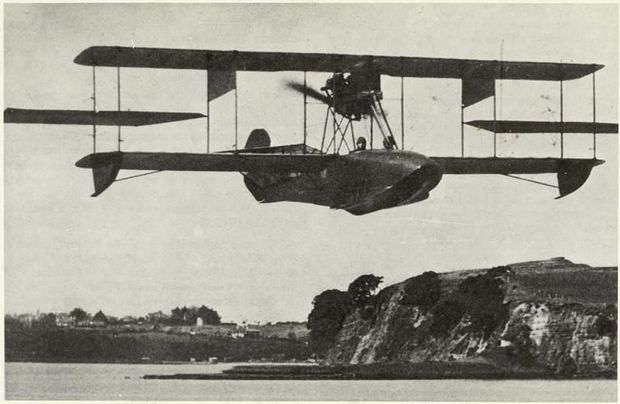 Image of the Walsh Brothers Flying School Curtiss flying boat flying above the eastern bays of Auckland