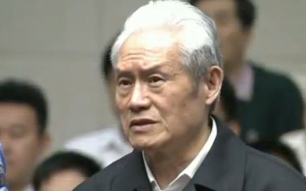 A screen grab taken from CCTV footage shows former Chinese security chief Zhou Yongkang standing on trial at the Intermediate People's Court in Tianjin.