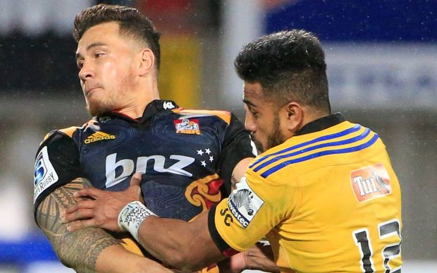 The Hurricanes Rey Lee-Lo and Chiefs Sonny Bill Williams collide.