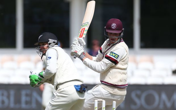 Craig Overton treads on his wicket and is out to Mark Craig during the four day game between Somerset and a New Zealand XI, 2015.