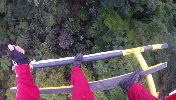 The paramedic was winched from about 36 metres above the track.