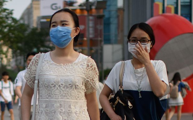 people wearing face masks in Seoul