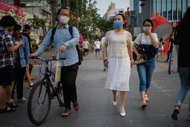 People wearing face masks in Seoul.