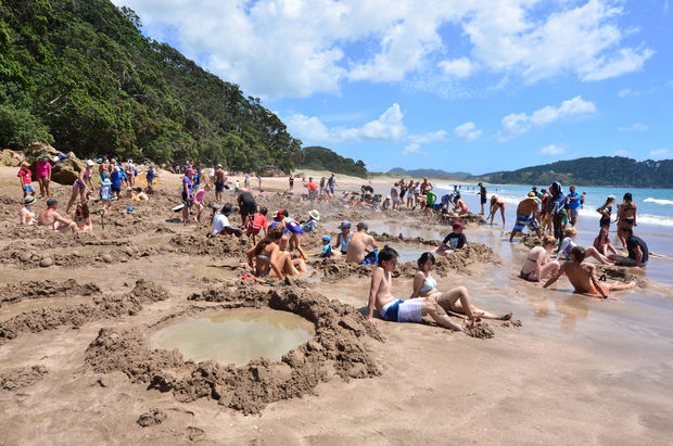 Visitors making small hot water pools in Hot Water beach