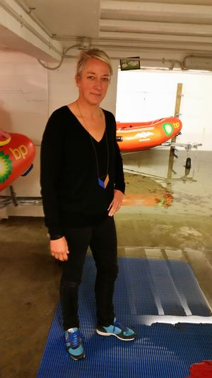 Maranui cafe co-owner Bronwyn Kelly standing in her flooded basement.