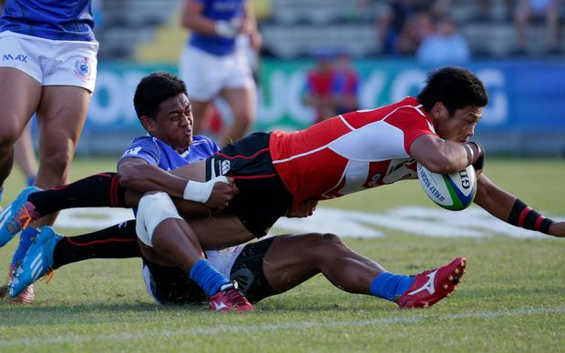 Full-back Ryuji Noguchi scores one of Japan's four tries in their win over Samoa.