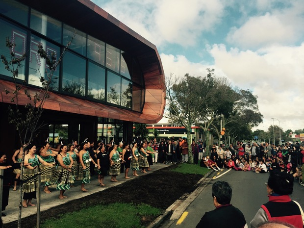 On opening day, local iwi perform a poi dance outside the entrance to Te Oro Glen Innes Music and Arts Centre.