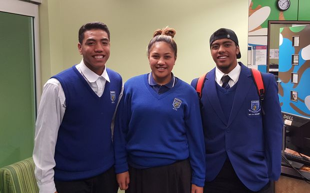 Tangaroa College students Lisi Tuifua, Carterina Kareroa Tusini and Lino Abraham at the book launch of 'Samoan Heroes'.