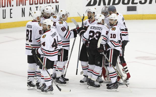 Blackhawks players celebrate their victory.