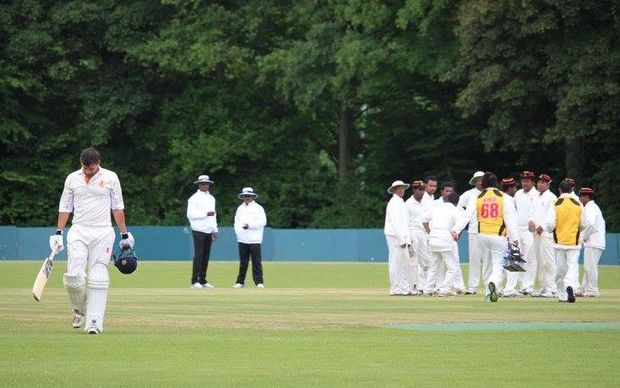 Papua New Guinea players celebrate a wicket in their four-day match against the Netherlands.