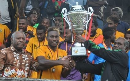 Vanuatu U23 football captain Brian Kaltack lifts the Friendship Cup trophy.