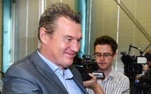 Sir John Kirwan smiles as he leaves the media conference announcing his resignation