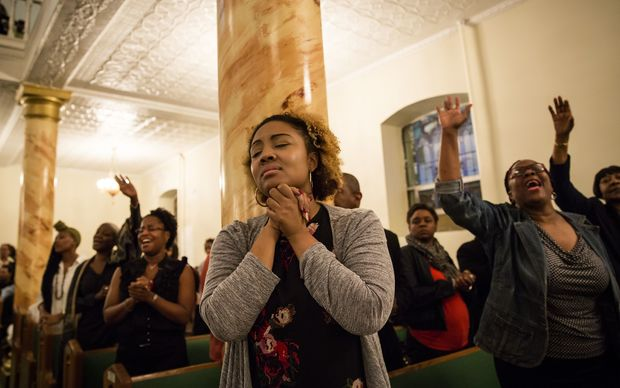 NEW YORK, JUNE 18: Mourners hold a prayer vigil for the victims of the shooting at First African Methodist Episcopal Church: Bethel, in the Harlem neighborhood of New York. The shooting took place at the Emanuel African Methodist Episcopal Church in Charleston, South Carolina.